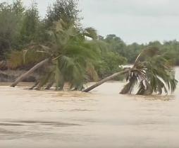 Climate Change: Coastal floods & erosion sweep community away